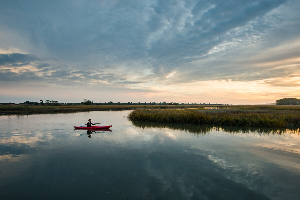 person in canoe on the kiawah river